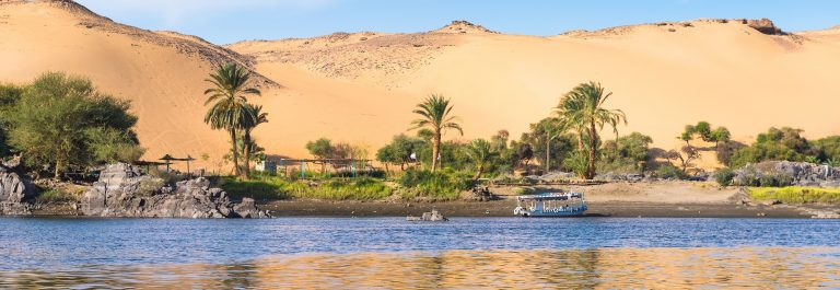 Sunset, Sand dunes on the Coastline of the Nile river part called First Cataract, Aswan, Egypt_238837702