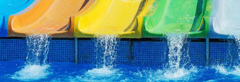 Colorful plastic water-slides in aqua park_593277455