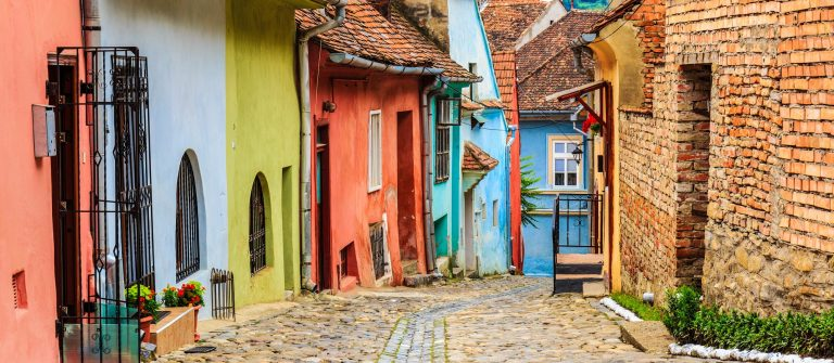 Medieval street view in Sighisoara founded by saxon colonists in XIII century, Romania shutterstock_209243932-2