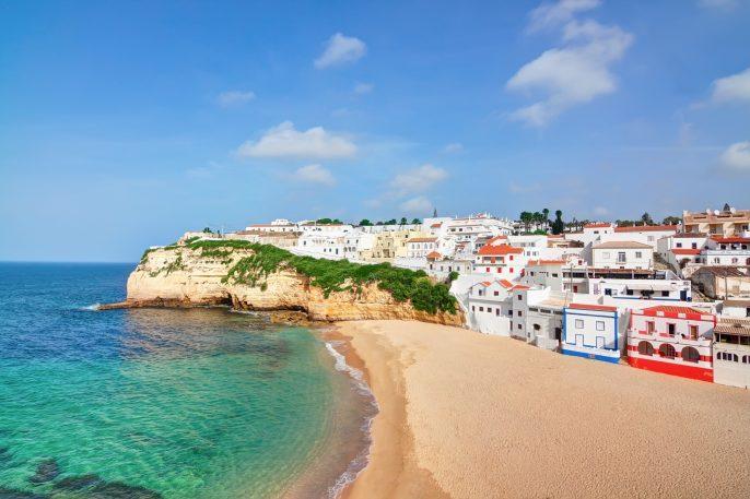Portuguese villa in Carvoeiro beach with clear blue sea.