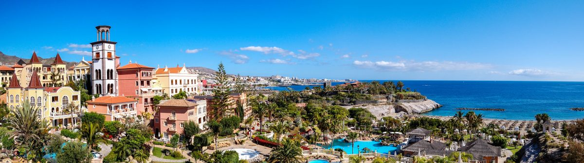 Panorama of luxury hotel and Playa de las Americas at background, Tenerife island, Spain shutterstock_89500042-2