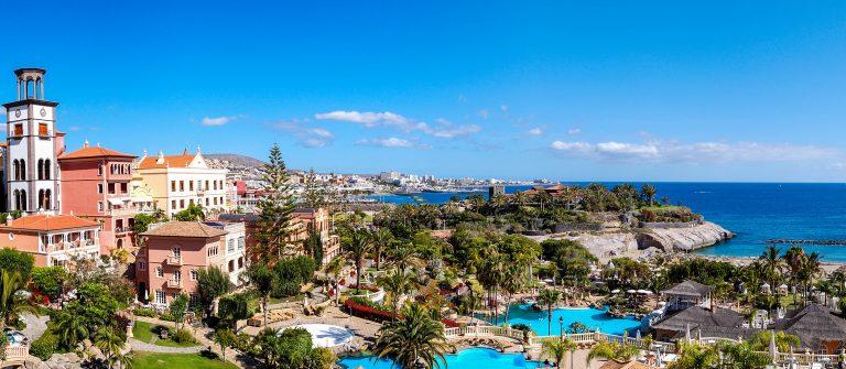 Panorama of luxury hotel and Playa de las Americas at background, Tenerife island, Spain shutterstock_89500042-2
