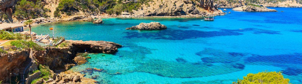 Amazing view of Cala Xarraca bay with azure sea water on northern coast of Ibiza island, Spain shutterstock_654896275