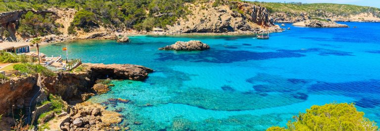 Amazing view of Cala Xarraca bay with azure sea water on northern coast of Ibiza island, Spain shutterstock_654896275