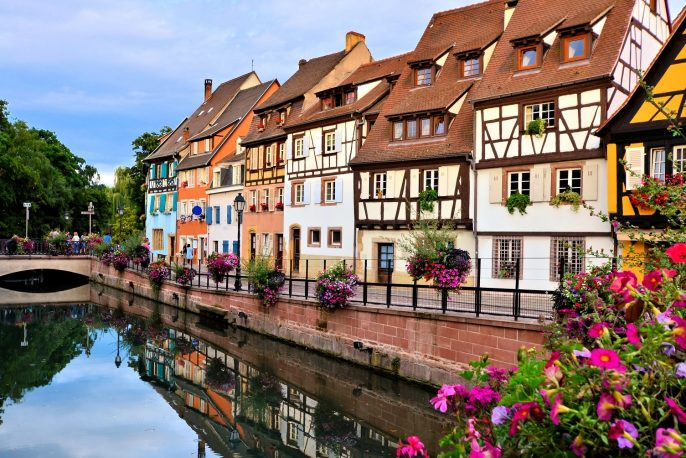 Beautiful canals of Colmar, France with late day reflections_shutterstock_410950825 – Copy