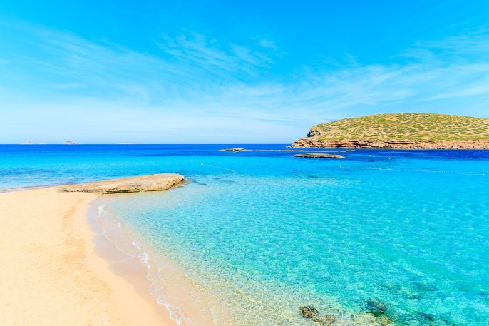 Beautiful sandy Cala Comte beach with azure blue sea water, Ibiza island, Spain shutterstock_650392843