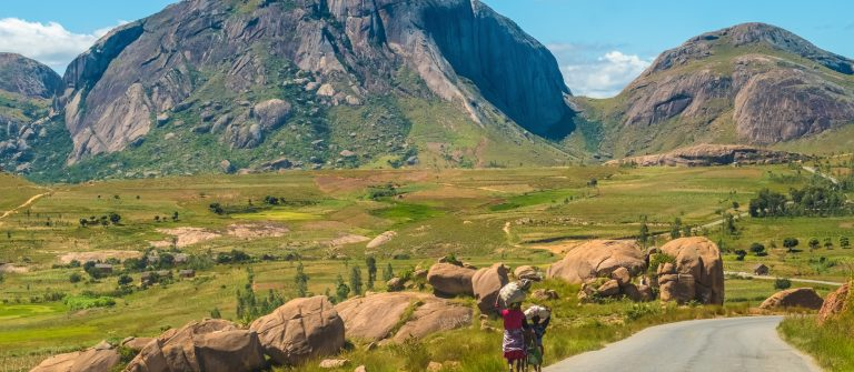 Betsileo people on foot, bicycle or zebu-powered carts on National Route 7 between Ambalavao and Isalo, Madagascar_1088435396