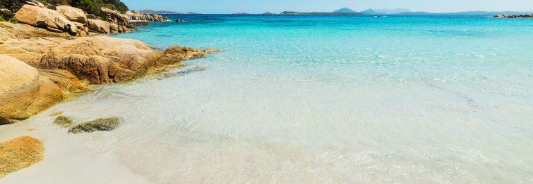 white sand and blue sea in Capriccioli beach