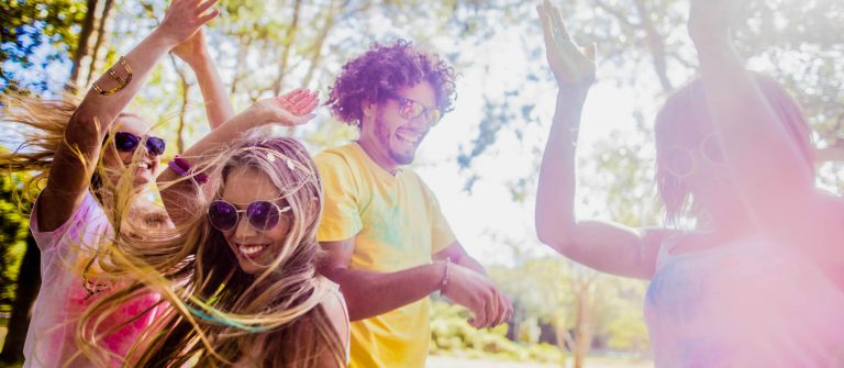 Multi-Ethnic Group Celebrating Holi Festival in Park