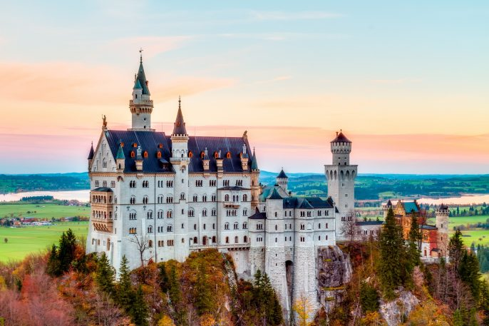 Neuschwanstein, Lovely Autumn Landscape Panorama Picture of the fairy tale castle near Munich in Bavaria, Germany with colorful trees in the morning hours shutterstock_163531187 – Copy