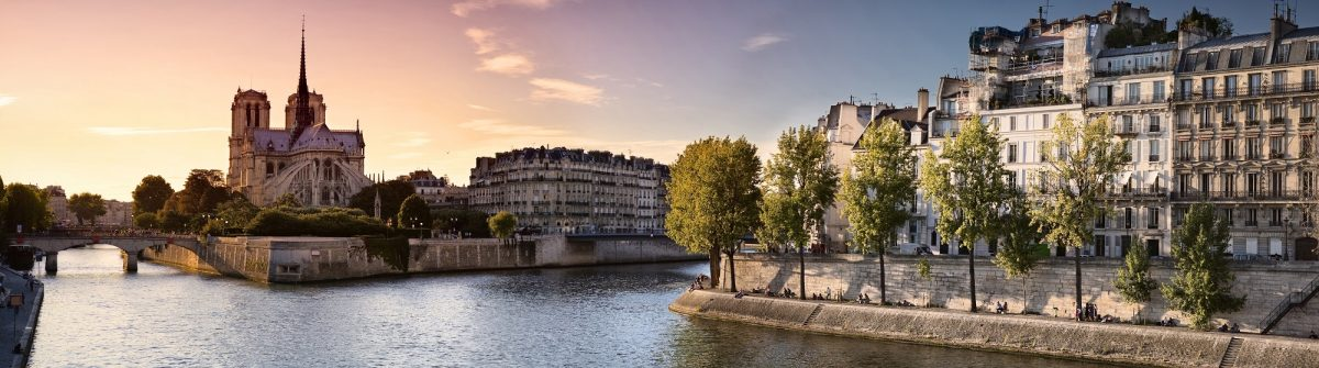 Notre Dame cathedral on Ile de la Cite in Paris, France seen from the Tournelle Bridge over River Seine. Part of Saint Louis Island on the right_shutterstock_128910458x2000