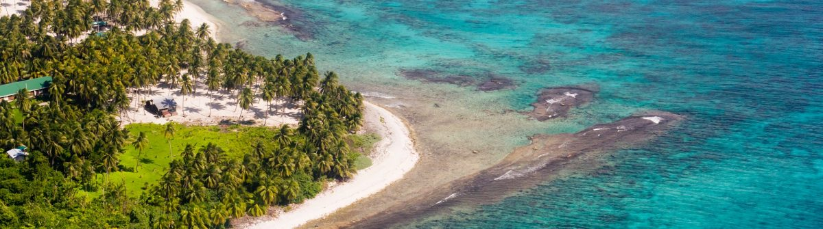 Aerial-view-of-the-barrier-reef-of-the-coast-of-San-Pedro-Belize_shutterstock_168178208