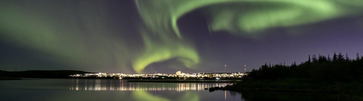 Aurora over Reykjavik city