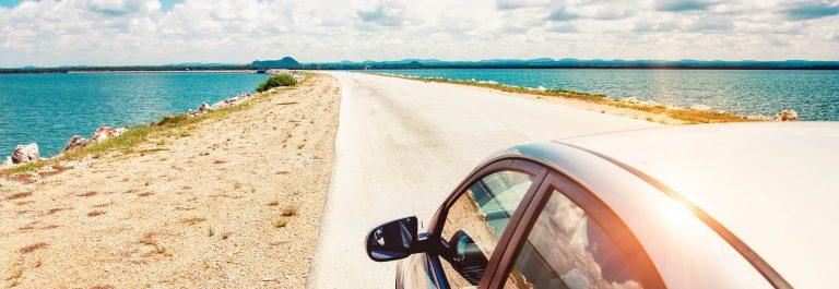 Car-driving-across-ocean-by-the-road-shutterstock_141621238-2