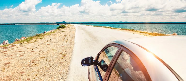 Car-driving-across-ocean-by-the-road-shutterstock_141621238-2