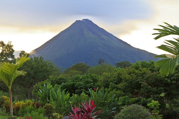 A-lush-garden-in-La-Fortuna-Costa-Rica-with-Arenal-Volcano-in-the-background_shutterstock_101362975_pix2000