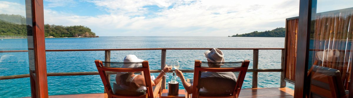 Couple relaxing in an over water bungalow