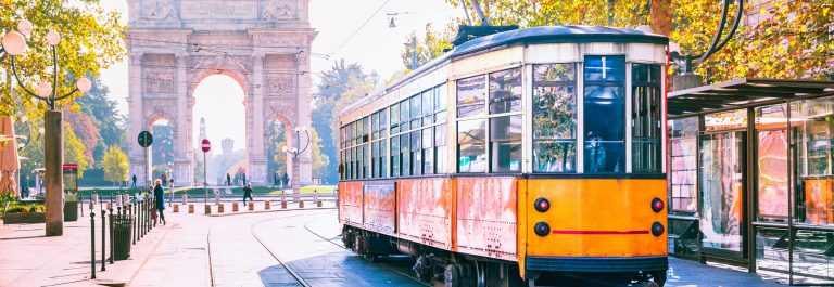 Famous-vintage-tram-in-the-centre-of-the-Old-Town-of-Milan-in-the-sunny-day-Lombardia-Italy.-Arch-of-Peace-or-Arco-della-Pace-on-the-background._786578662