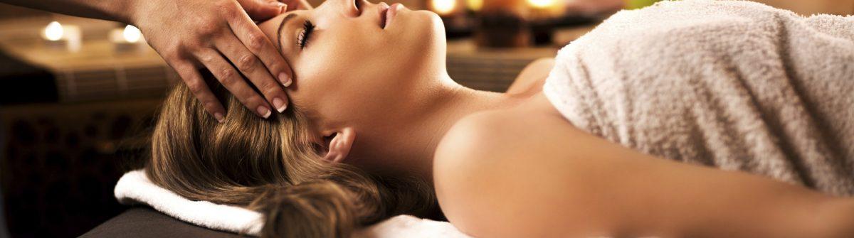 Woman receiving facial massage.