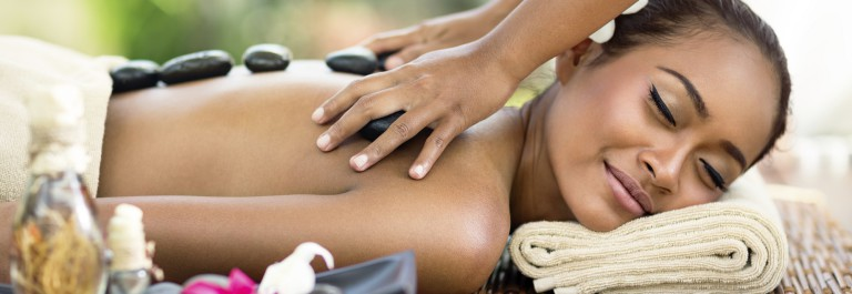 Young attractive woman enjoying in Asian massage