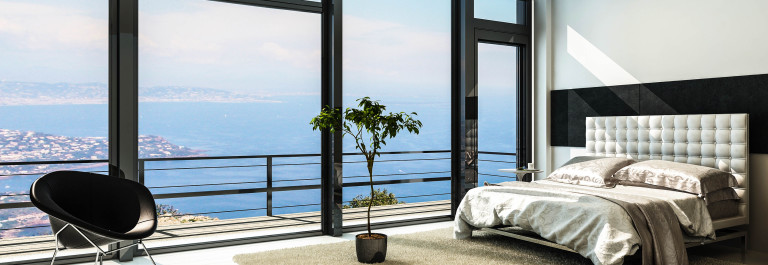 Contemporary modern sunny bedroom interior with huge windows shutterstock_159600293-2