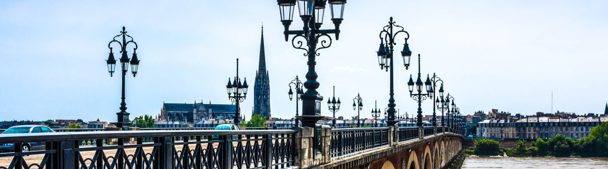 Famous Pont de Pierre in Bordeaux, France shutterstock_159261956-2