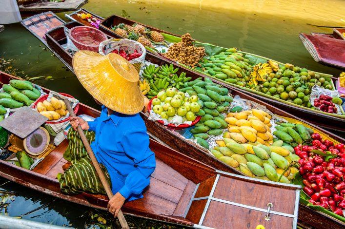 """Boats loaded with fruits in Damnoen Saduak Floating Market, Thailand"""