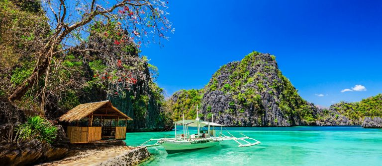 Filipino boat in the sea, Coron, Philippines shutterstock_171320501-2