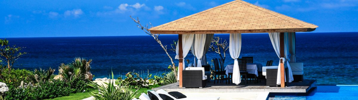 Luxury summerhouse with swimming pool on Atlantic ocean beach shutterstock_67081069-2