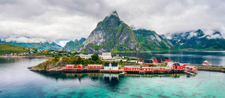 Scenic fjord on Lofoten islands with fishing hut and mountains
