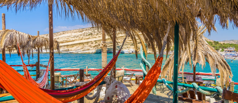 hammocks-at-matala-beach-crete-islad-shutterstock_226777786-2