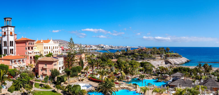 panorama-of-luxury-hotel-and-playa-de-las-americas-at-background-tenerife-island-spain-shutterstock_89500042-2