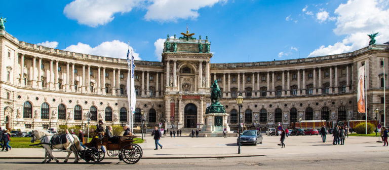 Hofburg palace, square view and fiacre or fiaker in Vienna