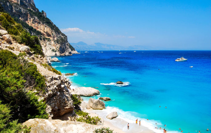 Blue beach with some people seen from the top. Cala Goloritze in summertime