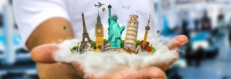 young-man-holding-a-cloud-full-of-famous-monuments-of-the-world-in-his-hands-shutterstock_386614045-2