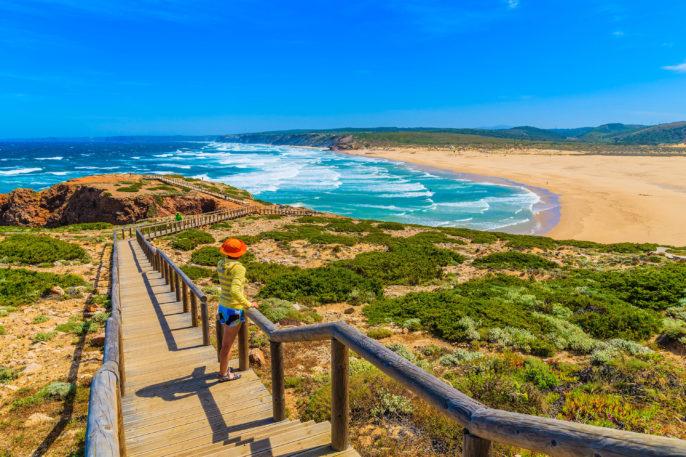 young-woman-tourist-on-walkway-to-praia-do-bordeira-beach-shutterstock_280701572-2