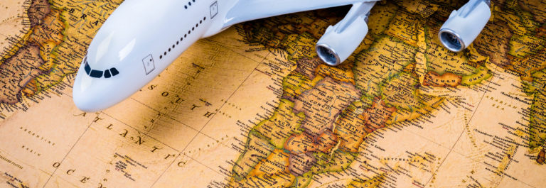 Model airplane on a background of old vintage map